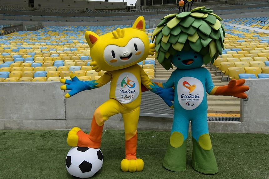 """The mascots for the Rio 2016 Olympic and Paralympic Games will be named """"Tom"""" (left) and """"Vinicius"""" after the singer-songwriters who wrote The Girl from Ipanema, the organisers said on Sunday. -- PHOTO: AFP"""