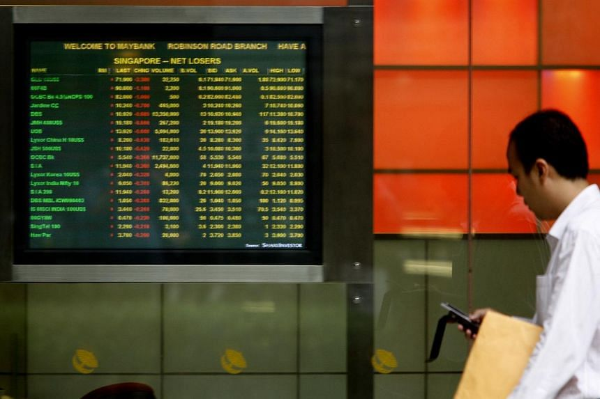 Further drops in oil prices and slumping shares across Asia sent Singapore stocks down almost 1 per cent on Monday. -- PHOTO: ST FILE