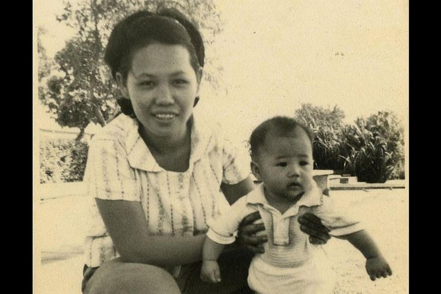 One-year-old Tay with his mother, Madam Ngo Ah Pin (above); and topping the sales team in his first month of work as a door-to-door encyclopaedia salesman in 1987. -- PHOTO: COURTESY OF TAY LAI HOCK
