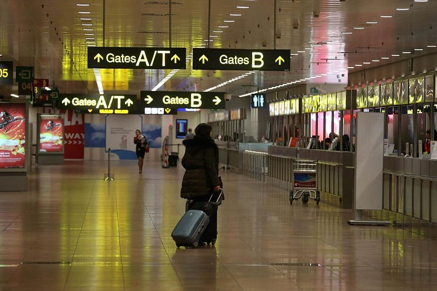 A photo taken on Dec 14, 2014 shows the near-empty Zaventem airport at the start of a 24-hour general strike in Belgium to protest against austerity measures taken by the federal government. Belgium braced itself on Dec 15 for the biggest national st
