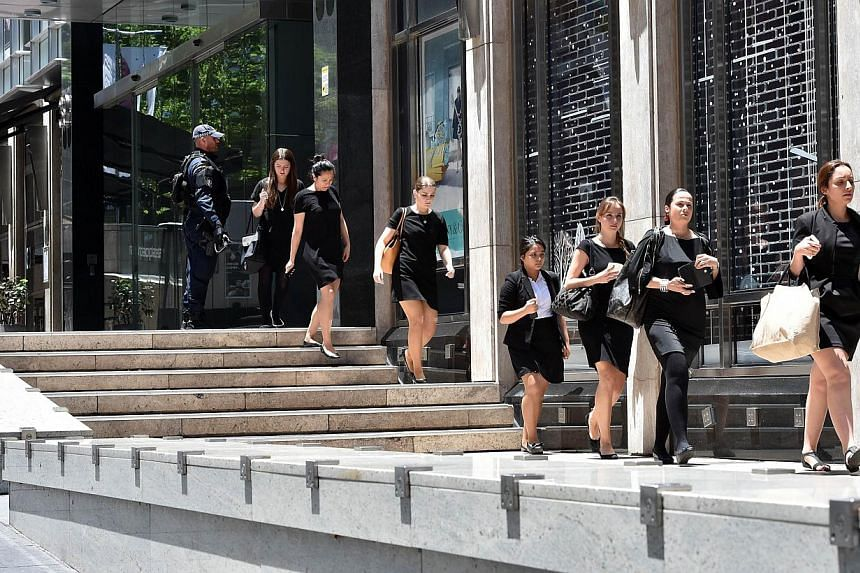 Commonwealth Bank of Australia, Westpac Banking Corp and Australia and New Zealand Banking Group said they had shut their Sydney CBD branches on Monday after a number of hostages were taken in a central city cafe. -- PHOTO: AFP