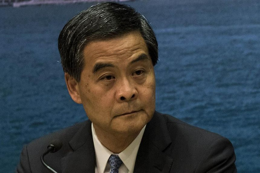 Hong Kong's leader Leung Chun Ying declared an end to more than 11 weeks of sit-in protests by pro-democracy demonstrators after police on Monday cleared the last remaining camp and arrested a handful of peaceful protesters. -- PHOTO: AFP