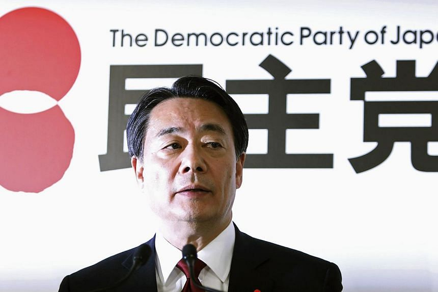 Japan's main opposition Democratic Party of Japan (DPJ) leader Banri Kaieda speaks during a news conference at the DPJ headquarters in Tokyo on Dec 15, 2014. -- PHOTO: REUTERS