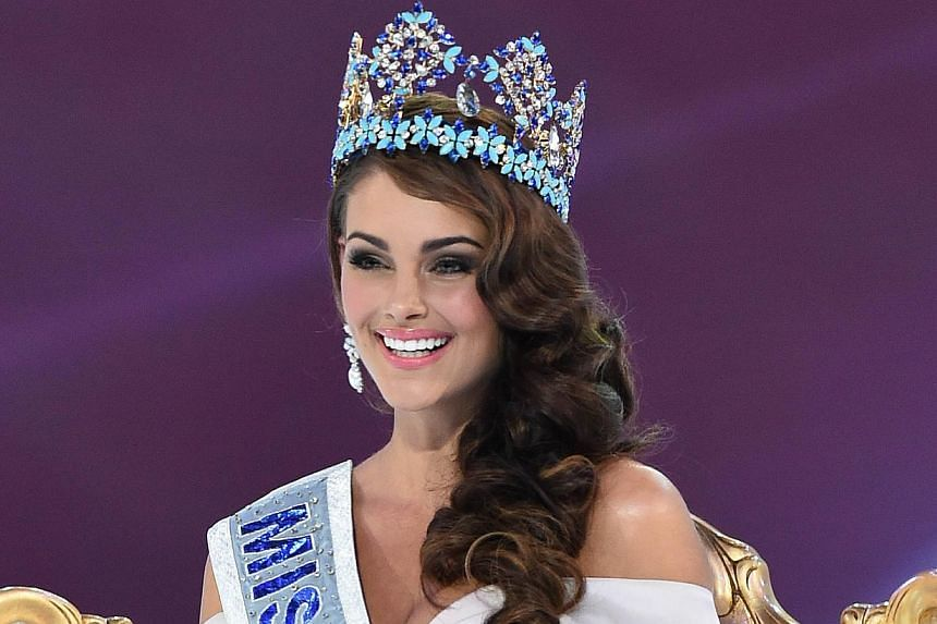 Miss South Africa and the 2014 Miss World, Rolene Strauss, poses in her seat after eing crowned during the grand final of the Miss World 2014 pageant at the Excel London ICC Auditorium in London on Dec 14, 2014. -- PHOTO: AFP