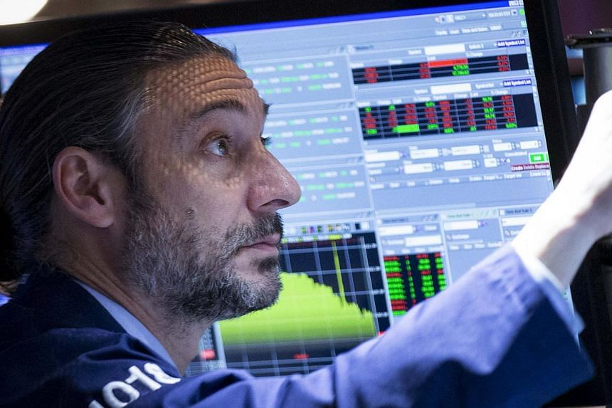 A trader works on the floor of the New York Stock Exchange on Dec 1, 2014. -- PHOTO: REUTERS
