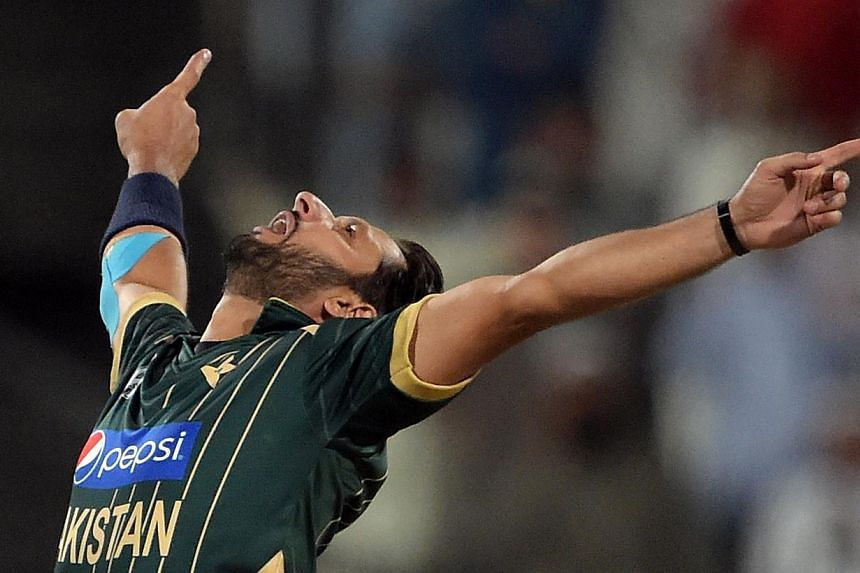 Pakistani captain and spinner Shahid Afridi celebrates after taking the wicket of New Zealand batsman Luke Ronchi during the third Day-Night International cricket match between Pakistan and New Zealand at the Sharjah cricket stadium in Sharjah on Sun