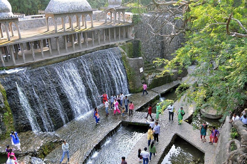 Indian visitors in the Rock Garden, built by self-taught Indian artist Nek Chand Saini over the course of 18 years, in Chandigarh. Deep inside his massive garden of handmade waterfalls and sculptures, he recalls toiling away secretly in the dea