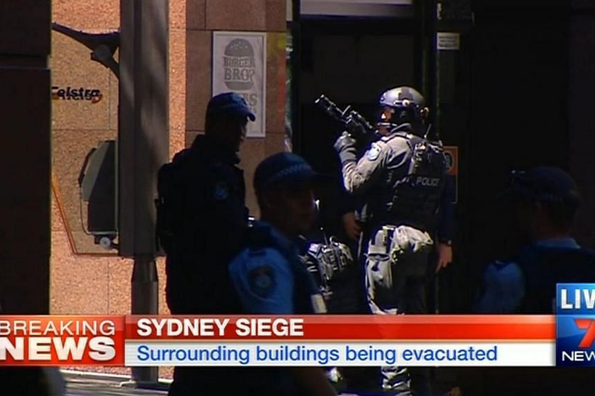 Screengrab from 7 News broadcasting live from the scene of the seige in Sydney. -- PHOTO: 7 NEWS