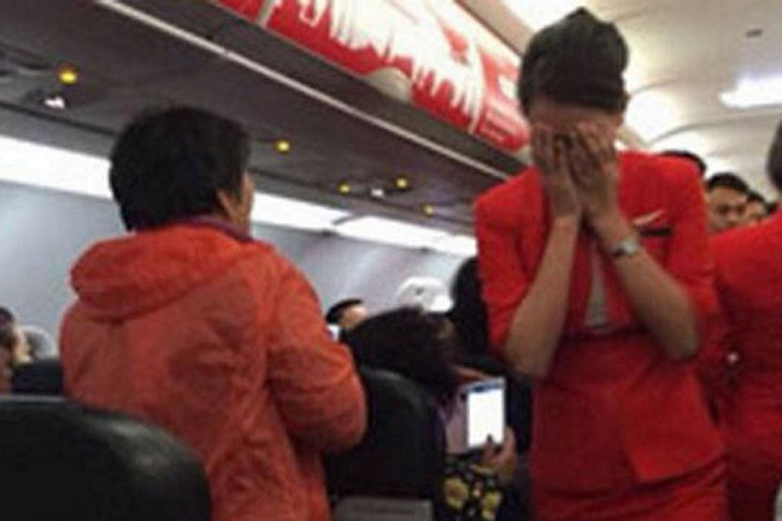 """Chinese state-run media branded four unruly air passengers """"barbarians"""" on Monday after they scalded an air hostess and threatened to blow up a plane in a dispute over seating. -- PHOTO: STOMP"""