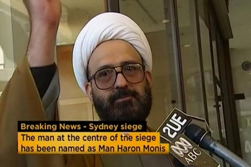 Australian Prime Minister Tony Abbott said the gunman who took hostages at a cafe in Sydney, Iranian refugee Man Haron Monis,was not on any terror watch list even though he was well-known to intelligence authorities and police. -- PHOTO: REUTER