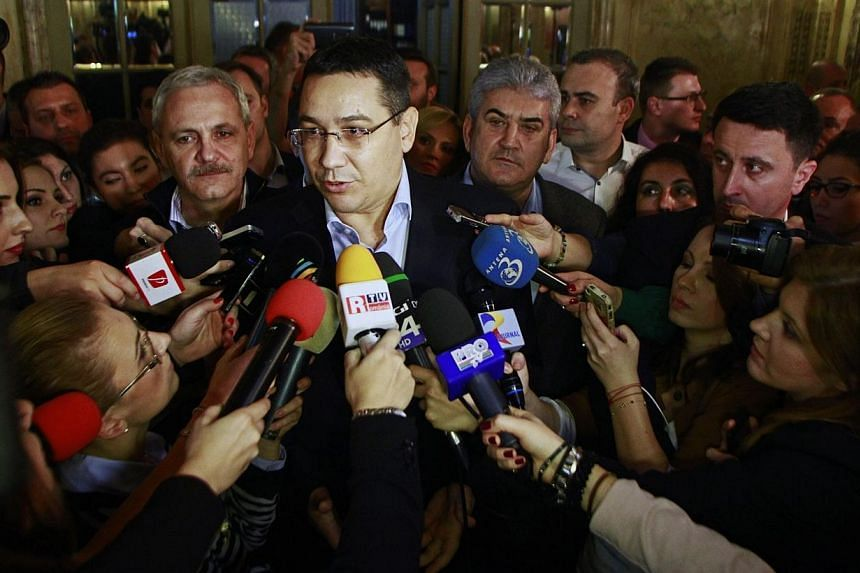 Romania's Prime Minister and presidential candidate Victor Ponta speaks to the media after exit-polls in Bucharest on Nov 16, 2014. -- PHOTO: REUTERS