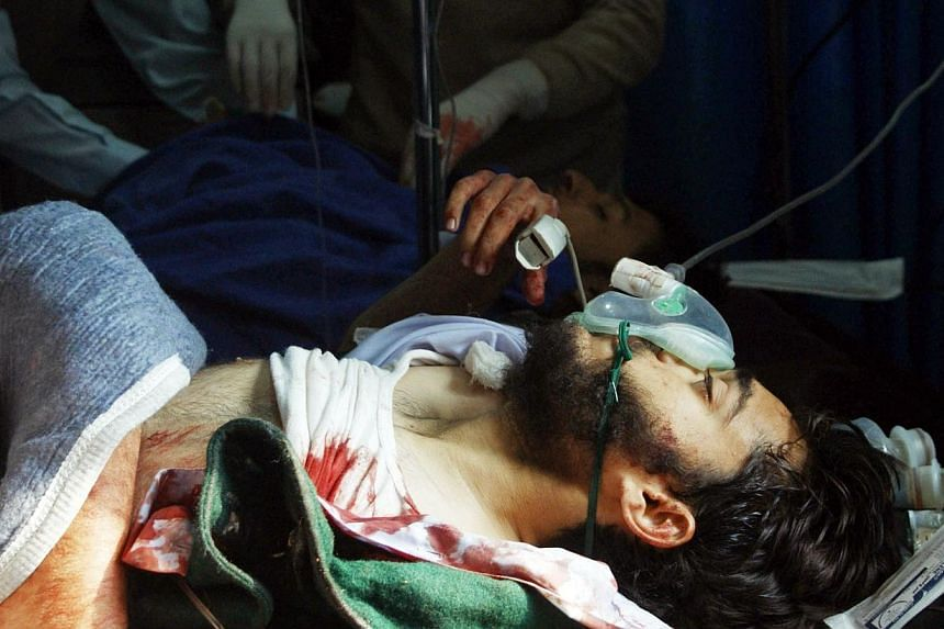 A wounded Pakistani student receives treatment at a hospital following an attack by Taleban gunmen on a school in Peshawar on Dec 16, 2014. -- PHOTO: AFP