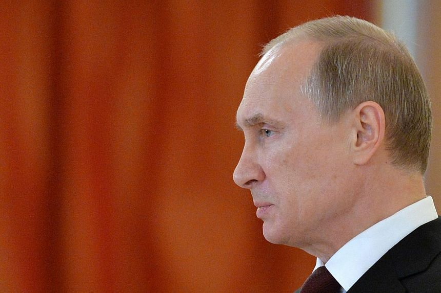 Russia failed to halt the collapse of the rouble on Tuesday, leaving President Vladimir Putin facing a full-blown currency crisis that could weaken his iron grip on power. -- PHOTO: AFP