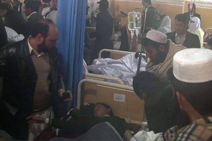 This screengrab taken from AFP footage shows a child receiving treatment at a hospital following an attack by Taleban gunmen on a school in Peshawar on December 16, 2014.-- PHOTO: REUTERS