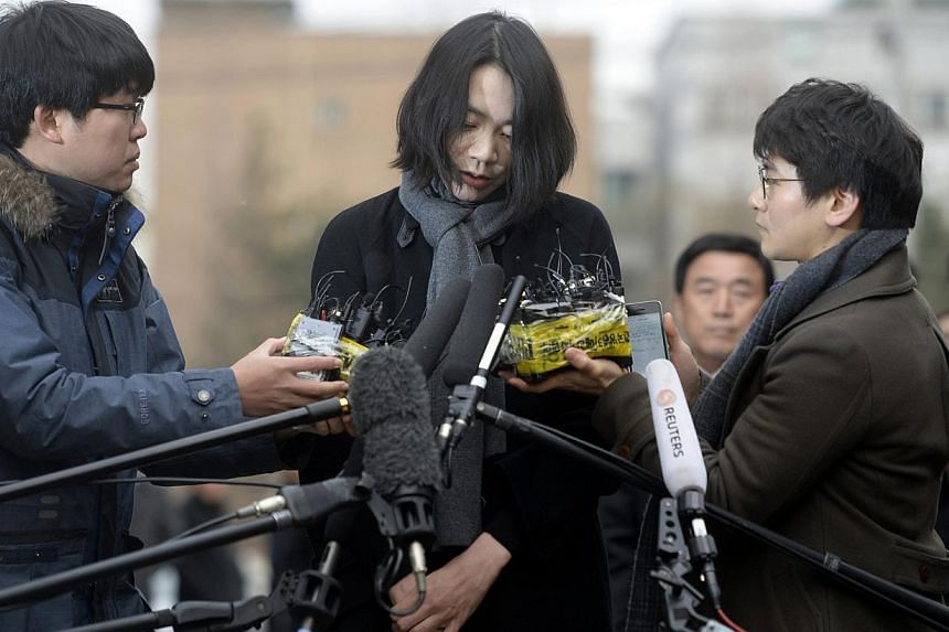 Former executive Heather Cho, daughter of Korean Air Lines chairman Cho Yang Ho, appears in front of the media outside the offices of the Aviation and Railway Accident Investigation Board of the Ministry of Land, Infrastructure, Transport, in Seoul o