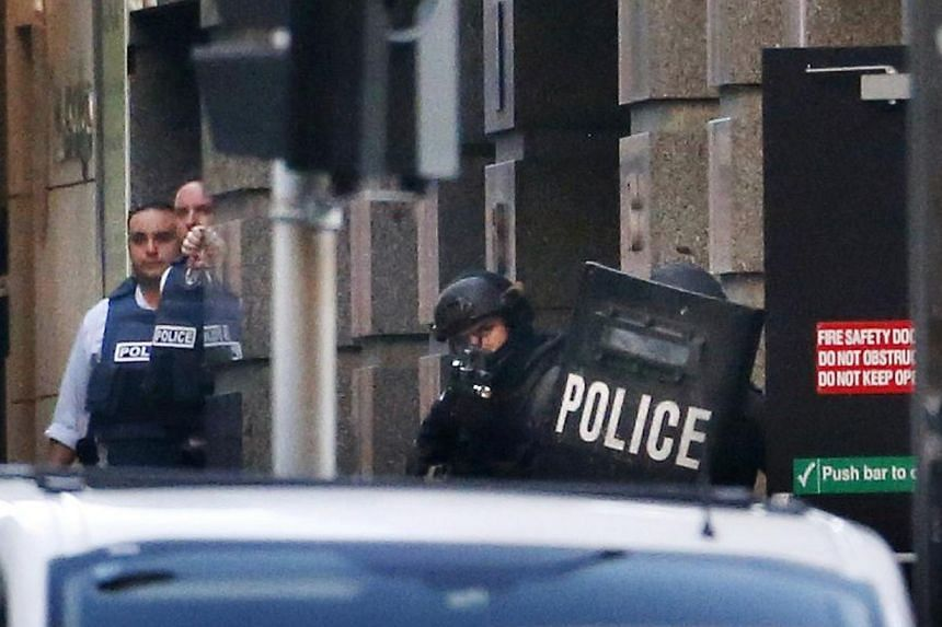 Police near the Lindt cafe at Martin Place in central Sydney on Dec 15, 2014. -- PHOTO: REUTERS