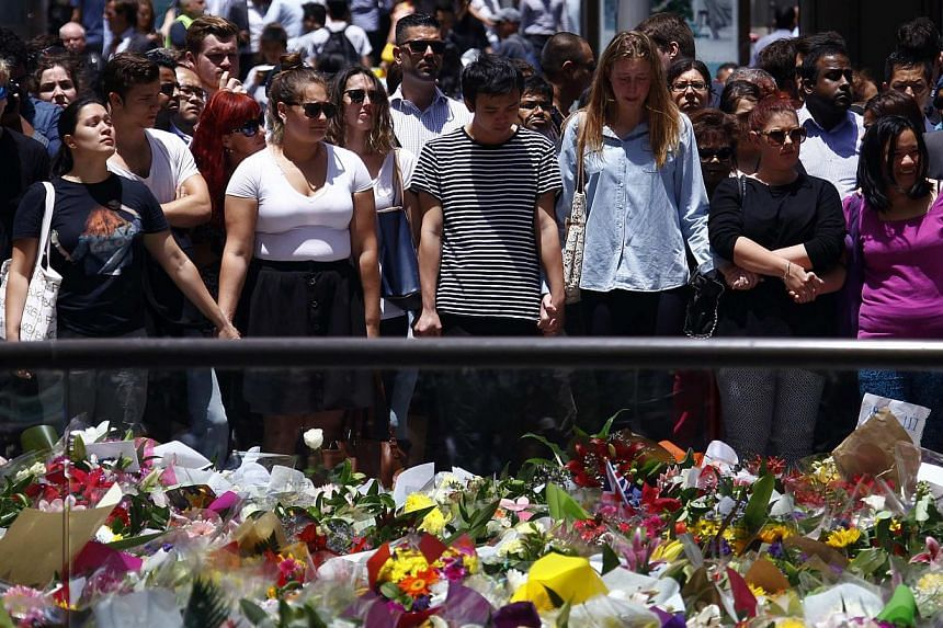 Floral tributes near the cafe in central Sydney on Dec 16, 2014, where hostages were held for over 16 hours. -- PHOTO: REUTERS