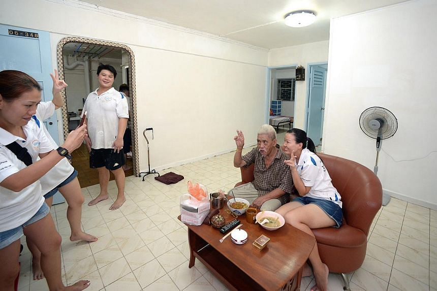 Mr Tan Soy Yong's previously cluttered three-room flat in Potong Pasir (above) got a makeover on Sunday (top right) by volunteers from Helping Joy, who also donated household items.