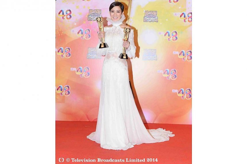 Charmaine Sheh with her awards.Line Walker, a rollicking undercover police comedy that salvaged TVB's ratings and which starred Sheh, was the big winner at the Hong Kong network's TVB Awards on Monday.-- PHOTO: TELEVISION BROADCASTS LIMIT