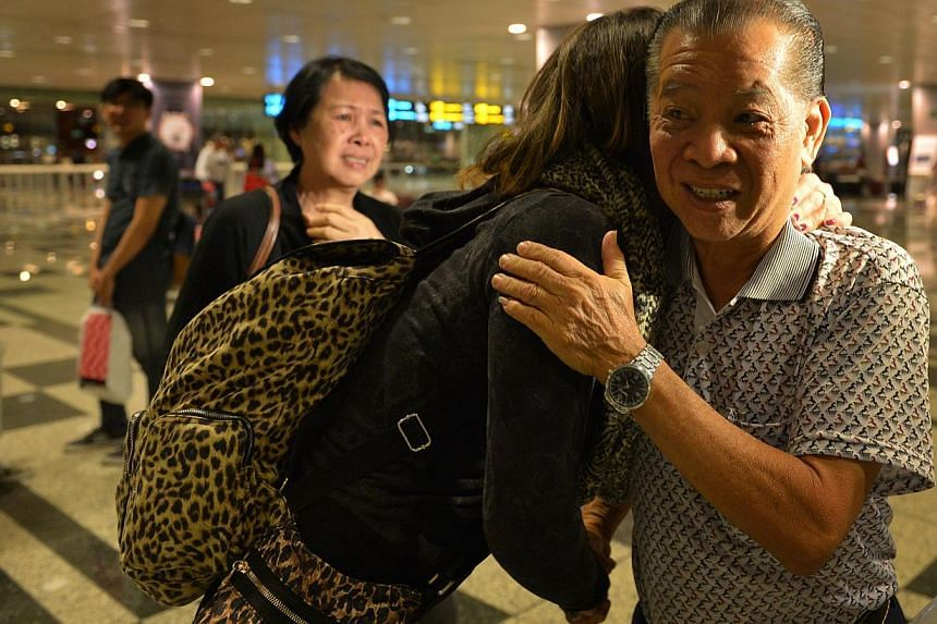 Colleen Turzynski hugs her uncle, Mr Lee Tak Nyen, at Changi airport. Colleen has just flown from Washington DC to meet her family members in Singapore. Colleen's aunt, Mdm Lee Say Moi (seen in this photo) was at the airport to receive her niece too.