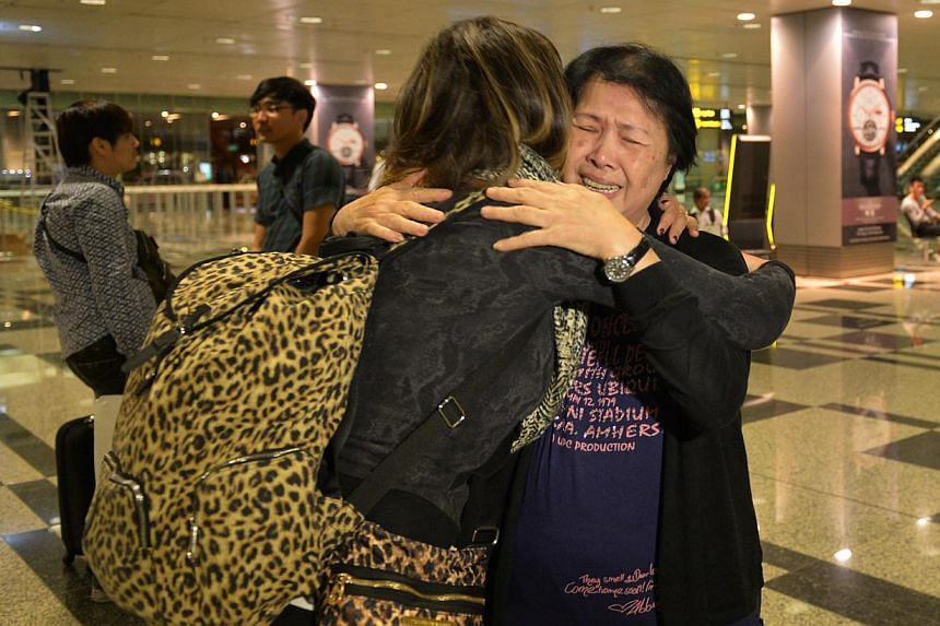 Colleen Turzynski hugs her aunt, Mdm Lee Say Moi, at Changi Airport Terminal 3. Colleen arrived in Singapore in the wee hours of Tuesday morning to reunite with her Singapore family members.-- PHOTO: CAROLINE CHIA