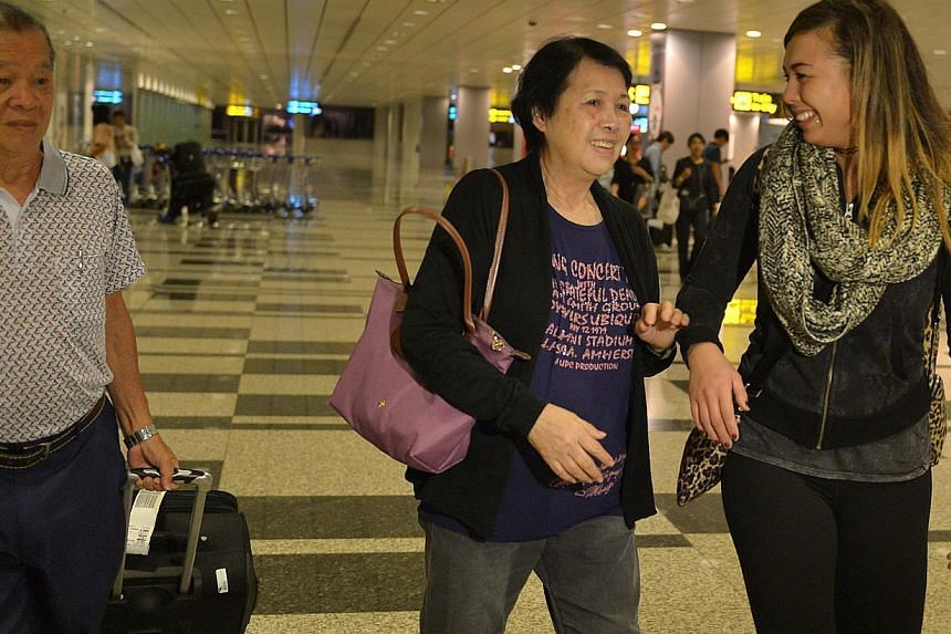 Colleen Turzynski is reunited with her Singapore family members, aunt, Mdm Lee Say Moi (centre) and her uncle Mr Lee Tak Nyen at Changi Airport.Colleen arrived from Washinton DC in the wee hours of Tuesday morning.-- PHOTO: CAROLINE CHIA