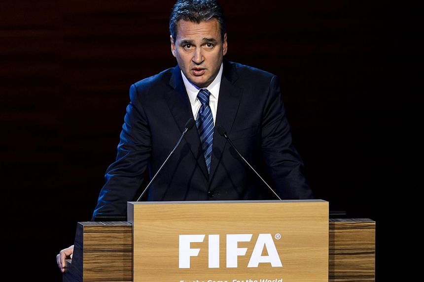 A file picture taken on June 11, 2014 shows FIFA ethics prosecutor Michael Garcia delivering a speech during the 64th FIFA congress in Sao Paulo, on the eve of the opening match of the 2014 FIFA World Cup in Brazil. -- PHOTO: AFP