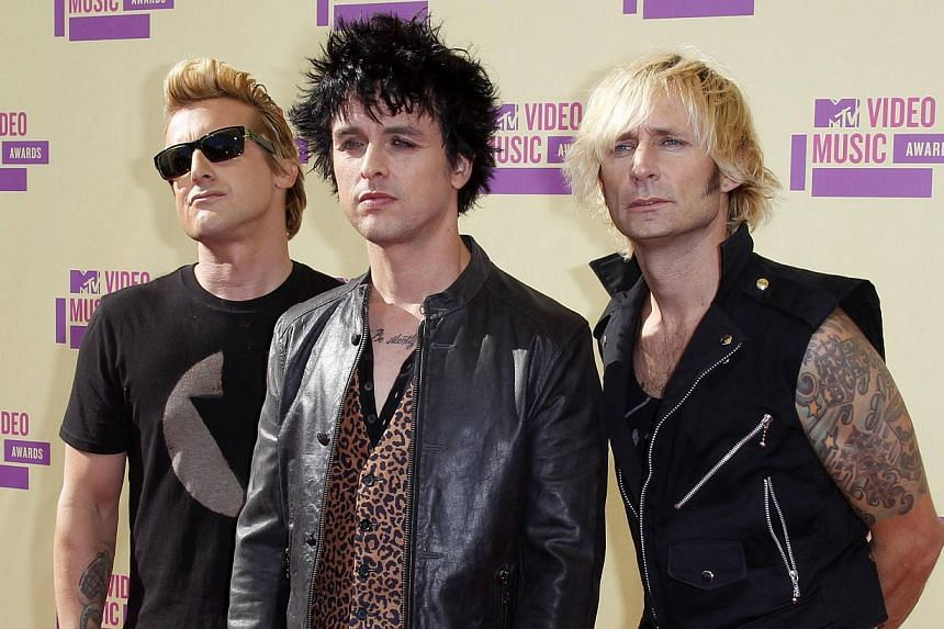 Green Day members (from left) Mike Dirnt, Billie Joe Armstrong and Tre Cool arrivefor the 2012 MTV Video Music Awards in Los Angeles, in this September 6, 2012 file photo. The latter-generation punk rock group on Tuesdaywon spots in the R