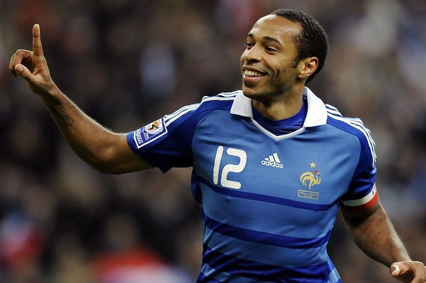 Present-day Arsenal stars led the tributes to club great Thierry Henry (above) on Tuesday after the former France striker announced his retirement from professional football. -- PHOTO: AFP