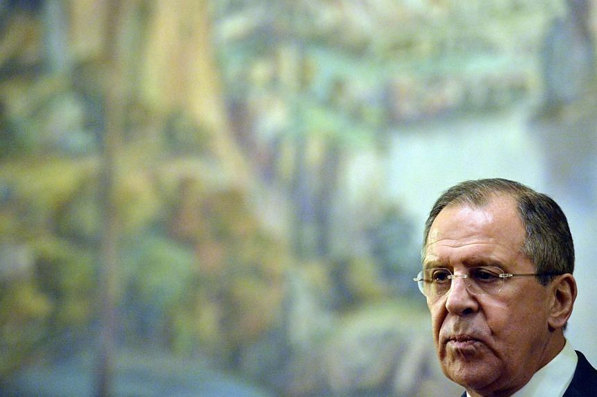 """Russia's foreign minister Sergei Lavrov (above) said on Tuesday he had """"very serious reasons"""" to think Western sanctions were an attempt to force regime change in Moscow. -- PHOTO: AFP"""