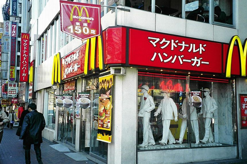 A McDonald's outlet in Japan. McDonald's Holdings in Japan is offering only small-sized french fries to customers as a protracted labour dispute at US West Coast ports has contributed to long delays in imports. -- PHOTO: THE NEW PAPER