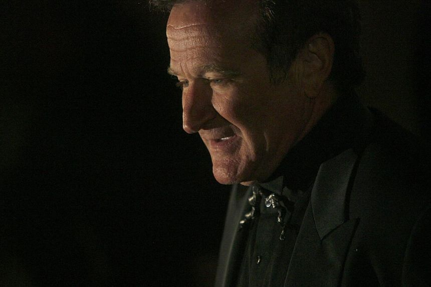 Actor Robin Williams arrives at singer-songwriter Elton John's 60th birthday party in New York in this Mar 24, 2007 file photo. -- PHOTO: REUTERS