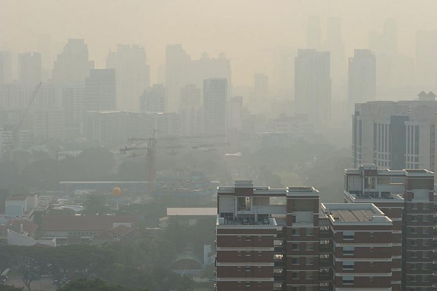 Haze obscuring the city skyline as seen from a block of flats in Strathmore Avenue in the morning of 3 November 2014. -- ST FILE PHOTO