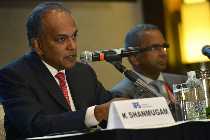 Minister for Law and Foreign Affairs K Shanmugam (left) said he had asked the Ministry of Law to review the framework for granting bailin light of the Sydney hostage situation on Dec 15, 2014.-- PHOTO: ST FILE