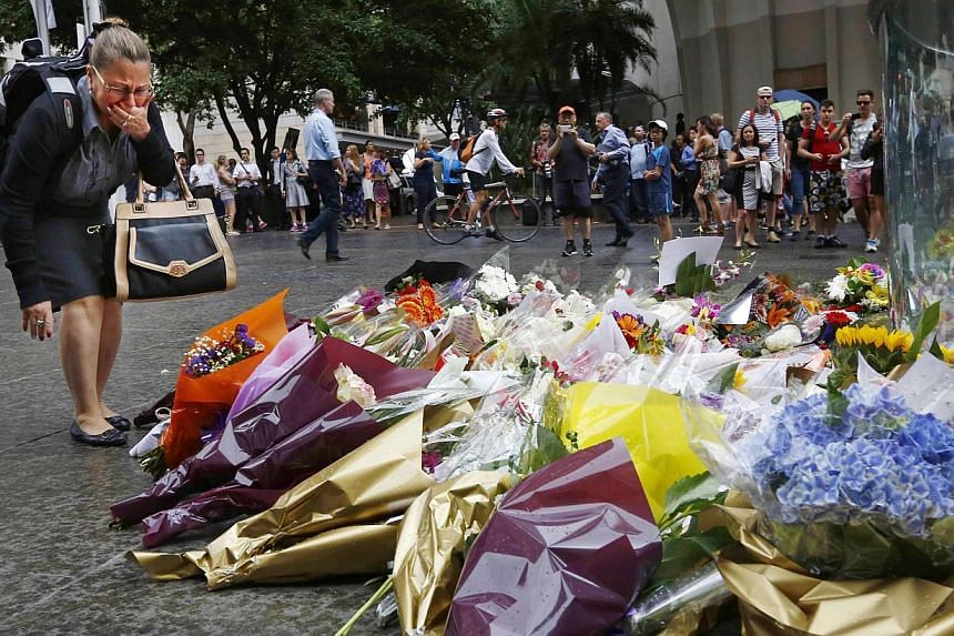 A floral tribute for those who died in the Sydney cafe siege, near the site of the incident, in Martin Place on Dec 16, 2014. -- PHOTO: REUTERS