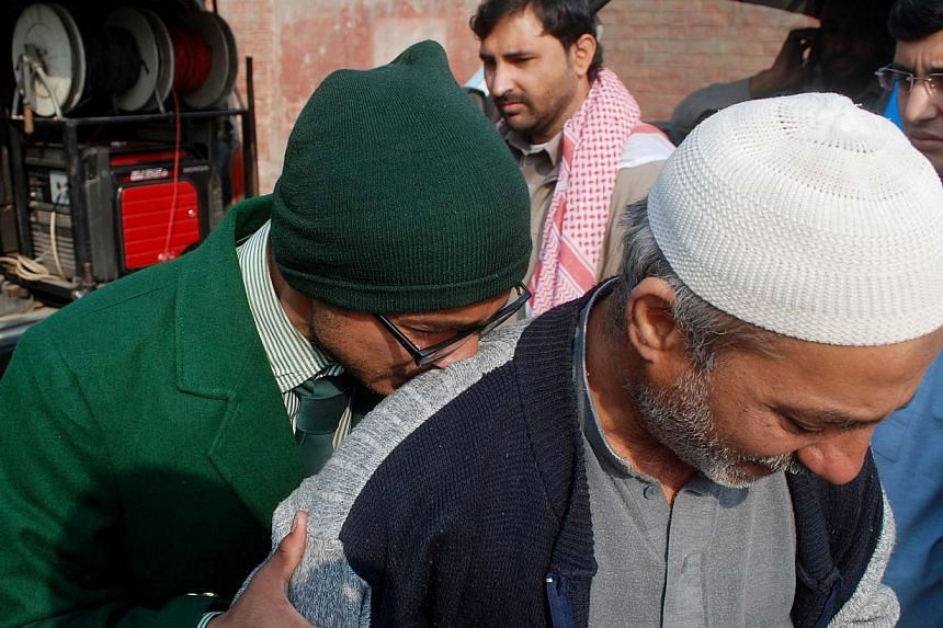 A student cries on a man's shoulder, after he was rescued from the Army Public School that in under attack by Taleban gunmen in Peshawar on Dec 16, 2014.-- PHOTO: REUTERS