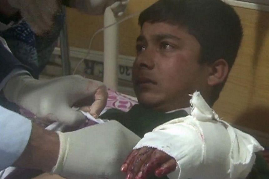 This screengrab taken from AFP footage shows a child receiving treatment at a hospital following an attack by Taleban gunmen on a school in Peshawar on Dec 16, 2014. -- PHOTO: AFP