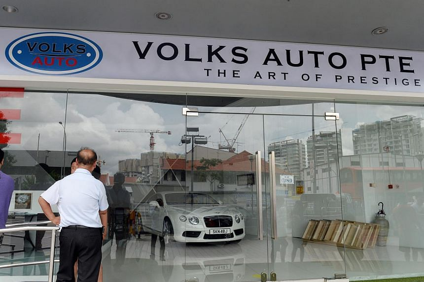 More than 20 people gathered outside Volks Auto at Macpherson on Dec 15, 2014. -- ST PHOTO: AZIZ HUSSIN