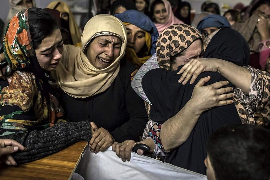 Women mourn their relative Mohammed Ali Khan, 15, a student who was killed during the attack. -- PHOTO: REUTERS