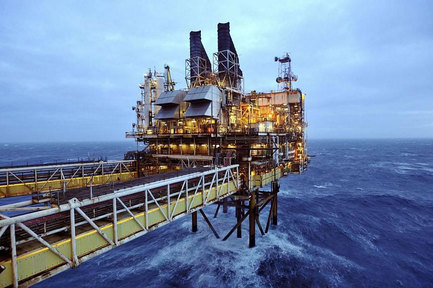 Part of the BP Eastern Trough Area Project oil platform in the North Sea. Oil sank to new lows in Asia on Dec 17 as dealers watch Russia's rouble crisis and await the latest US crude supply report. -- PHOTO: REUTERS