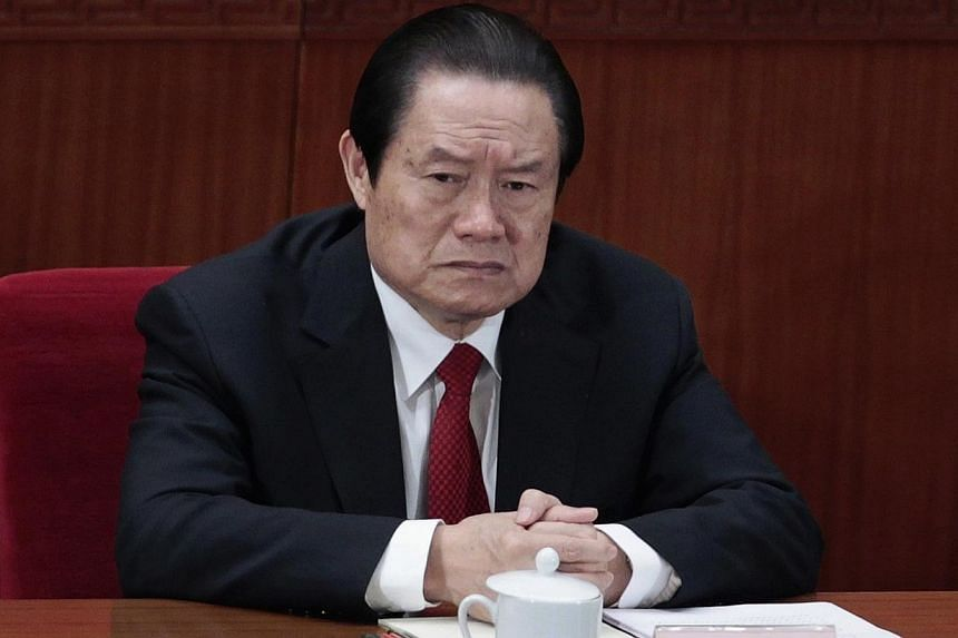 China's former Politburo Standing Committee Member Zhou Yongkang attends the closing ceremony of the National People's Congress (NPC) at the Great Hall of the People in Beijing in this March 14, 2012 file photo. -- PHOTO: REUTERS
