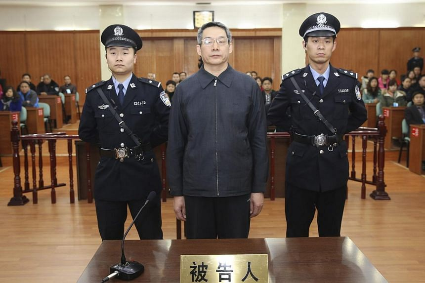 Liu Tienan (centre), the former deputy head of China's top planning agency, stands during his verdict at a court in Langfang, Hebei province, in this Dec 10, 2014 handout photo supplied by the Langfang Intermediate People's Court. -- PHOTO: REUTERS