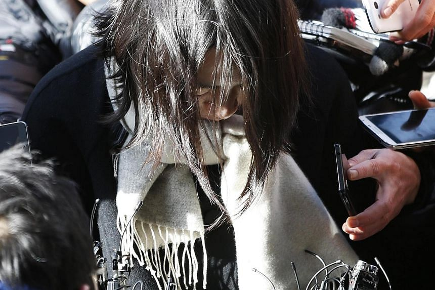 Cho Hyun Ah, also known as Heather Cho, daughter of chairman of Korean Air Lines, Mr Cho Yang Ho, is surrounded by media upon her arrival at the Seoul Western District Prosecutor's Office in Seoul on Dec 17, 2014. -- PHOTO: REUTERS