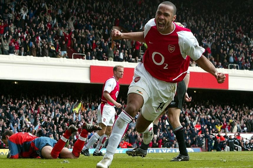 Thierry Henry celebrating scoring for Arsenal against Liverpool at Highbury in 2004. -- PHOTO: ACTION IMAGES