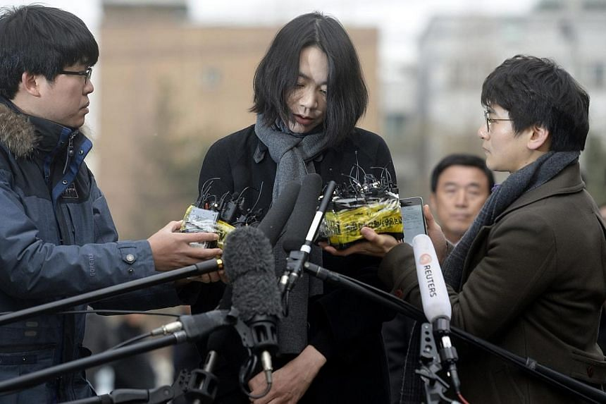 Cho Hyun Ah, also known as Heather Cho, daughter of Korean Air chairman, Cho Yang Ho, appears in front of the media outside the offices of the Aviation and Railway Accident Investigation Board of the Ministry of Land, Infrastructure, Transport, in Se