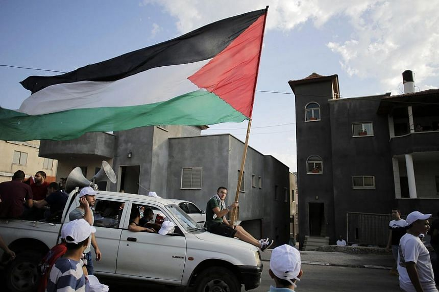"""The European Parliament overwhelmingly backed the recognition of a Palestinian state """"in principle"""" on Wednesday, Dec 17, 2014, following a series of votes on the issue in EU nations which have enraged Israel. -- PHOTO: REUTERS"""