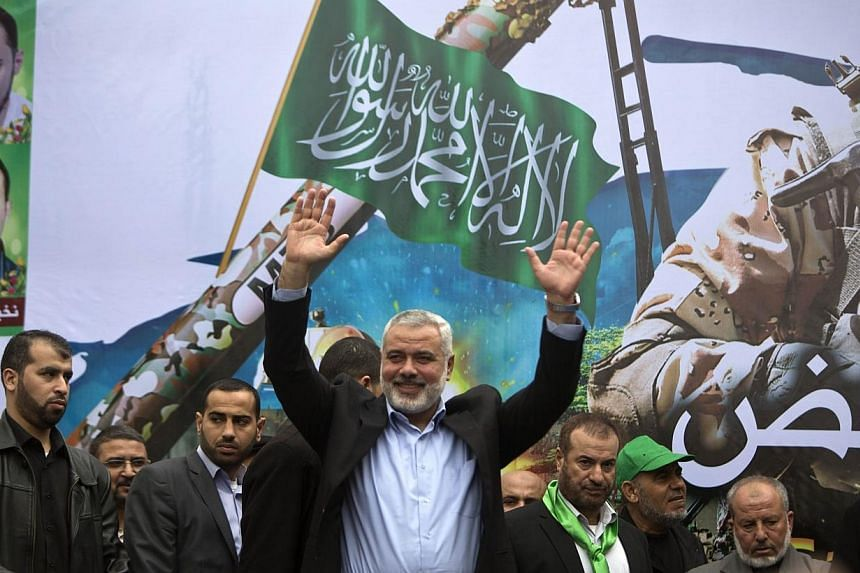 Gaza Hamas leader Ismail Haniya greets supporters during a rally to commemorate the 27th anniversary of the Islamist movement's creation and to ask for the reconstruction of the Gaza Strip on Dec 12, 2014 in Jabalia refugee camp in the northern Gaz