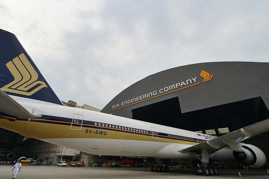 A Singapore Airlines (SIA) Boeing 777-300 is seen parked in the SIA Engineering Company hangar at Changi on Sept, 25 2013. The Competition Commission of Singapore (CCS) is seeking feedback on the proposed joint venture between the Boeing Company