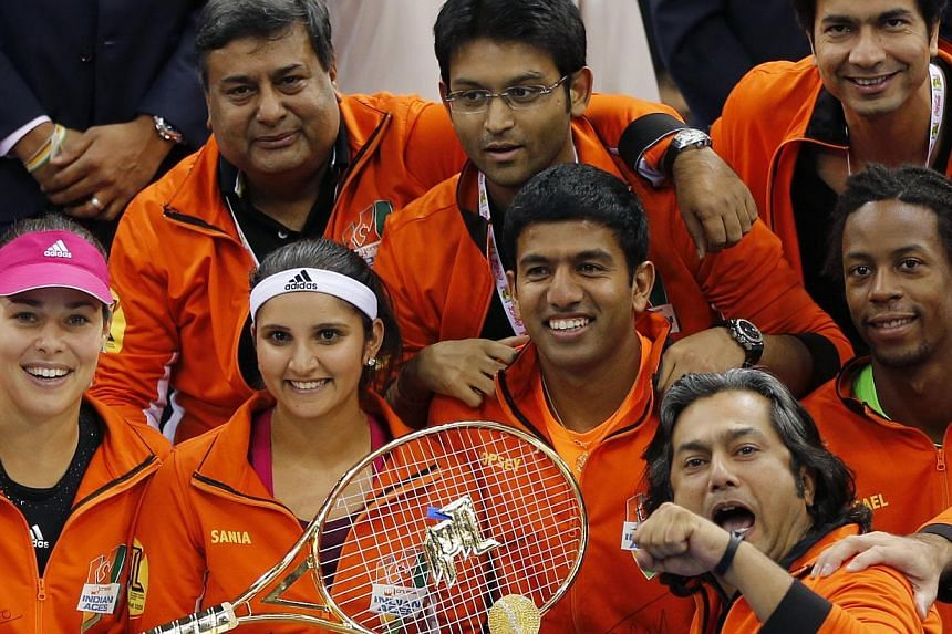 The Indian Aces team celebrates after winning the International Premier Tennis League in Dubai on Dec 13, 2014. -- PHOTO: REUTERS