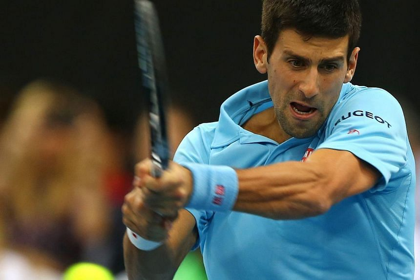 Serbian player Novak Djokovic of the UAE Royals returns the ball to France's Gael Monfils of the Indian Aces during their International Premier Tennis League match at the Hamdan Sports Complex in Dubai on Dec 13, 2014. -- PHOTO: AFP